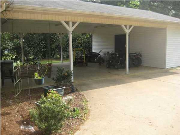 Carport behind the garage